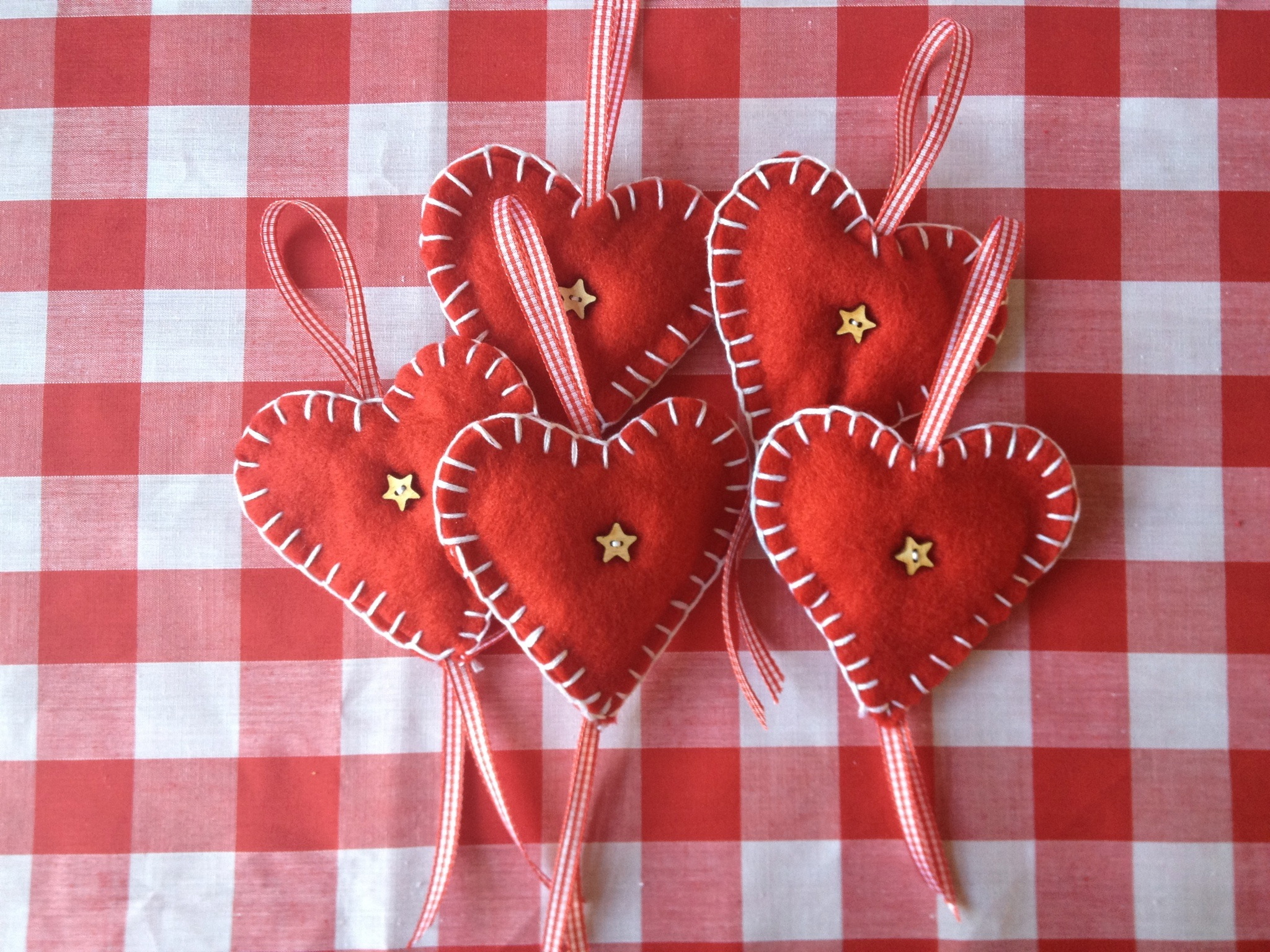 Red felt heart christmas decorations inspired by those